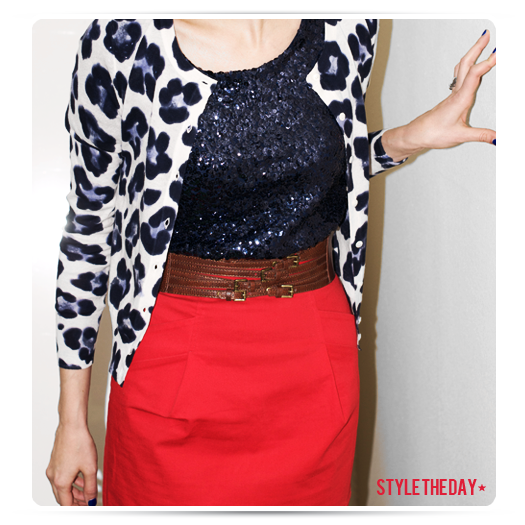 Red skirt, navy sequin top and patterned sweater.